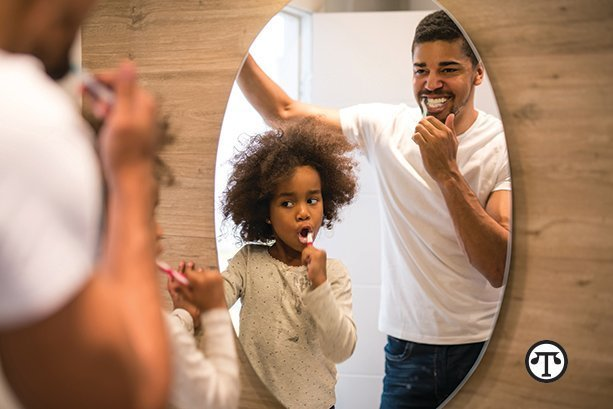 Brush and floss your teeth with your children so they learn good habits.