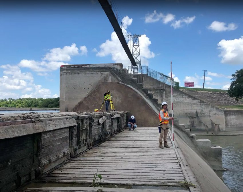 Guadalupe-Blanco River Authority staff and engineers inspect the damage done to Gate No. 2 at the Lake Gonzales spillgate after a tree caused damage during the nighttime hours of Aug. 3. The inspection revealed there are no mechanisms available to repair the spillgate and GBRA is determining how to find funding for a replacement.