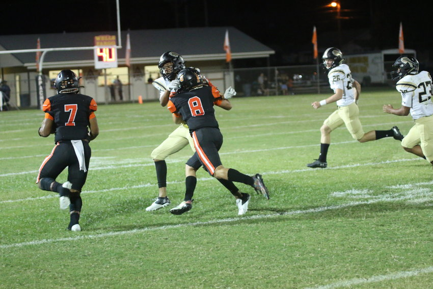 Quarterback Jarren Johnson (7) hits the outside on a keeper for 24 yards with blocking help from Carson Gaytan (8).