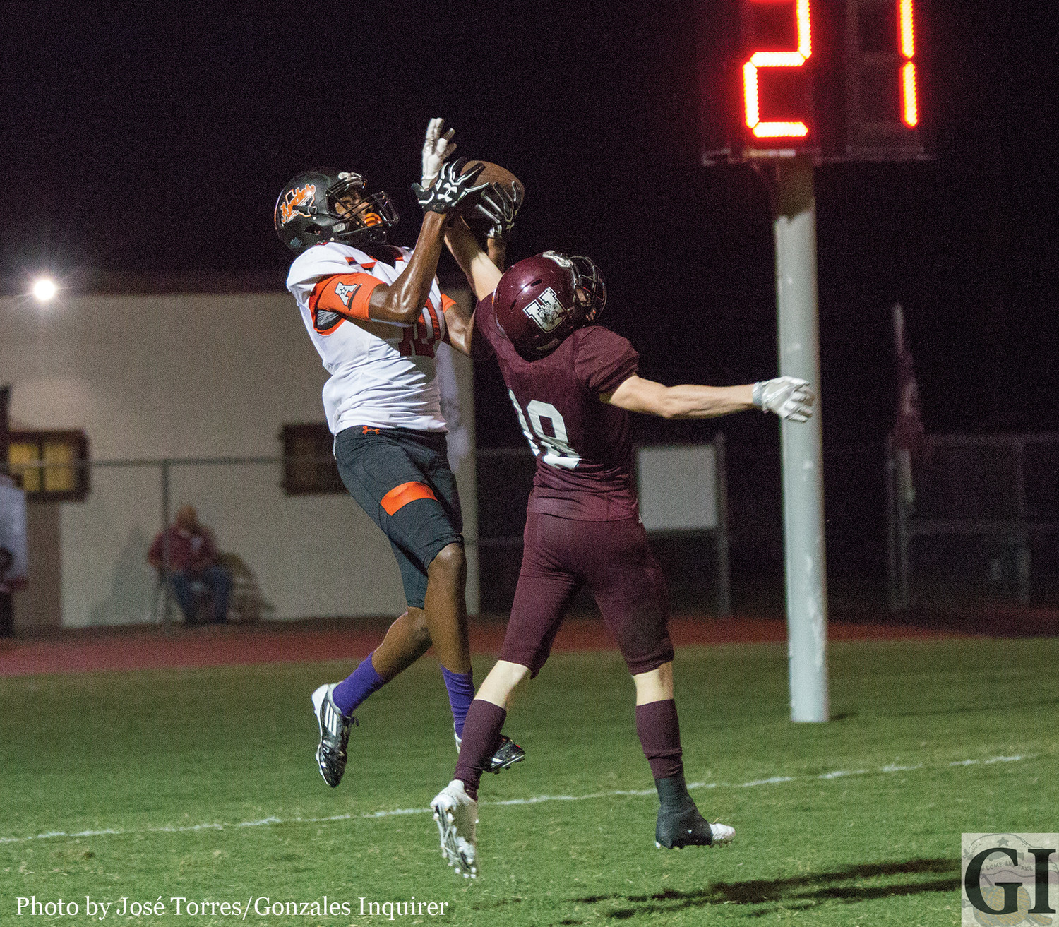 Trevion McNeil (10) snags a touchdown pass in the end zone during the Apaches' 34-20 win.