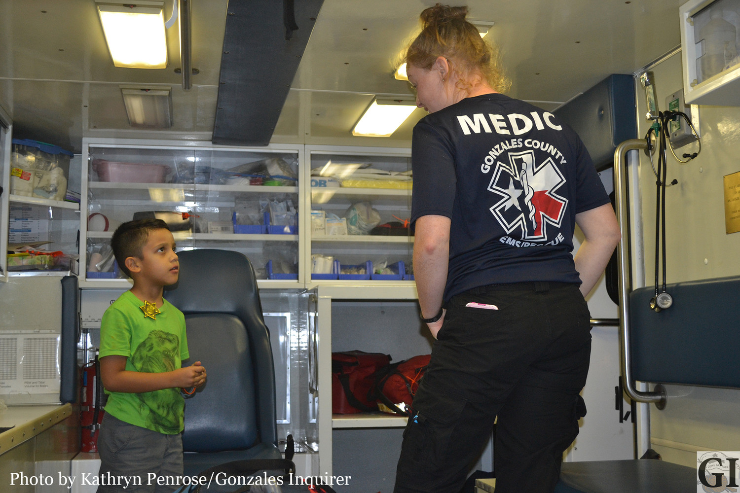 TJ Garza got a tour of a Gonzales County Emergency Medical Services Rescue Unit, during National Night Out Tuesday night. EMT Christine Brown showed the inquisitive youngster the unit and talked to him about emergency services.