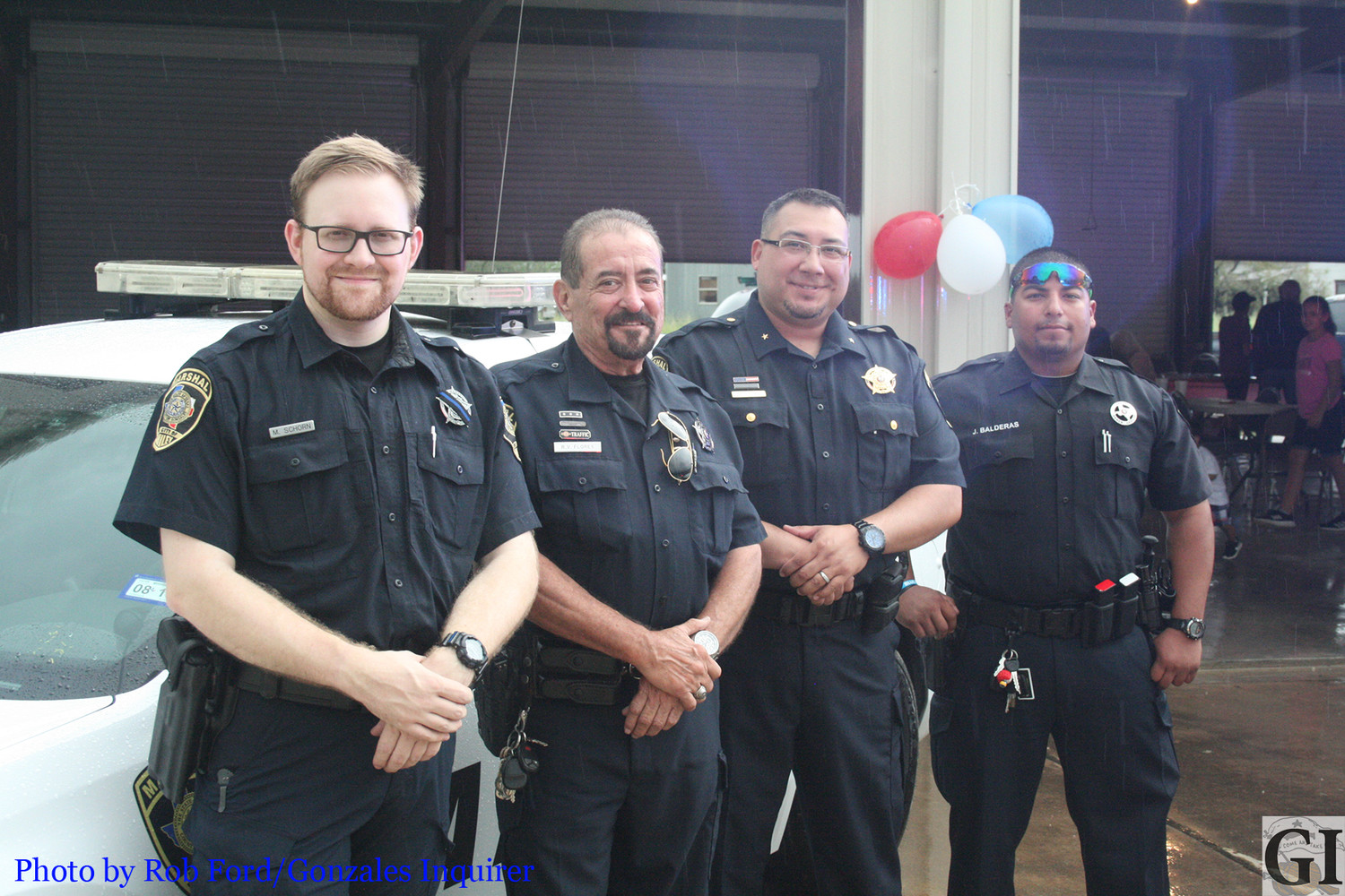 Nixon and Smiley held about 100 people at their respective National Night Out events despite the heavy rains Tuesday.