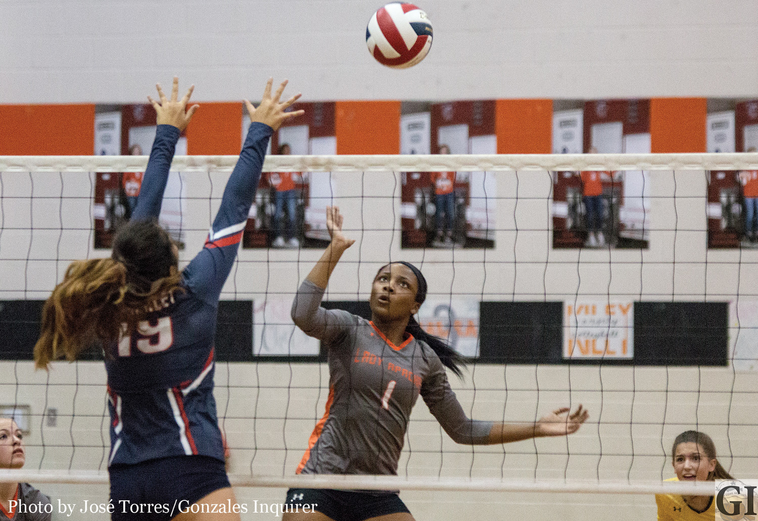 Chelsie Hastings (1) tries for a tip in the Lady Apaches' three-set loss to Wimberley.
