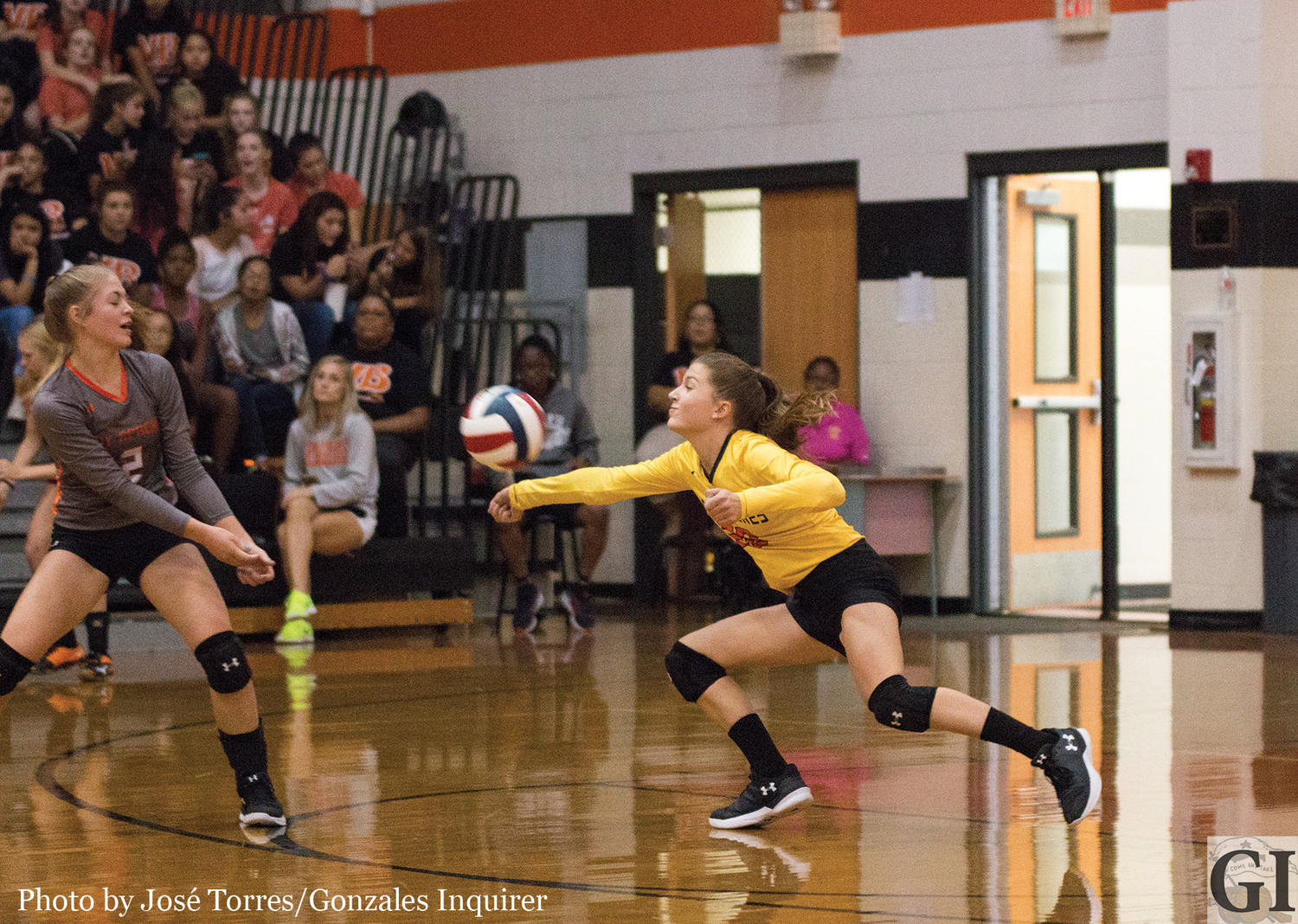 Sam Barnick (20) stretches out for a dig during a Gonzales three-set loss to Wimberley Tuesday night.