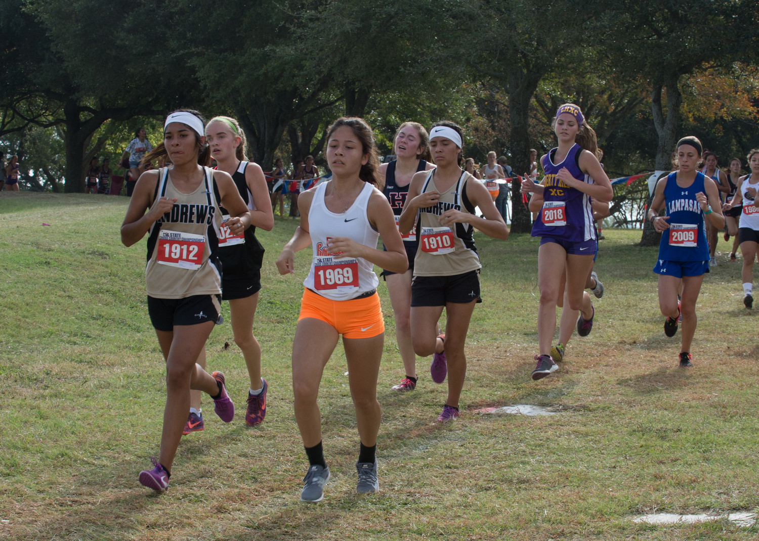 Senior Romy Cantu (#1969) finishes out her final cross-country meet as a Gonzales Lady Apache.