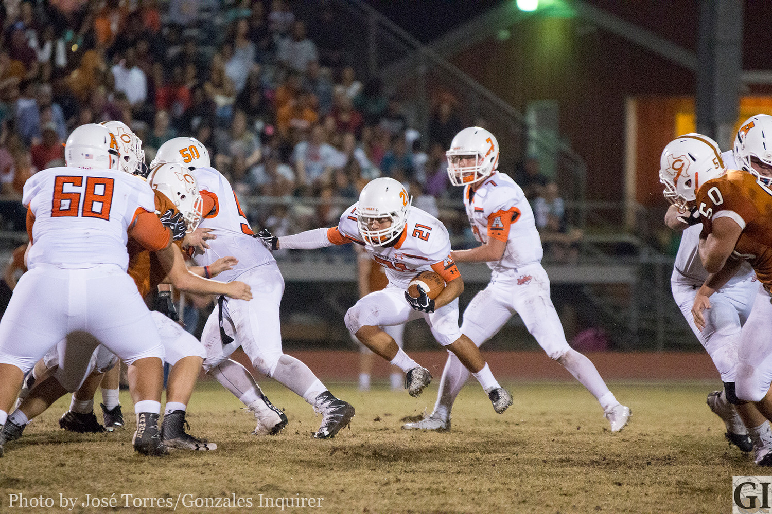Kalub Carrizales (21) finds a running lane opened up by the Apache offensive line during Gonzales' 19-14 loss against Caldwell Friday night.