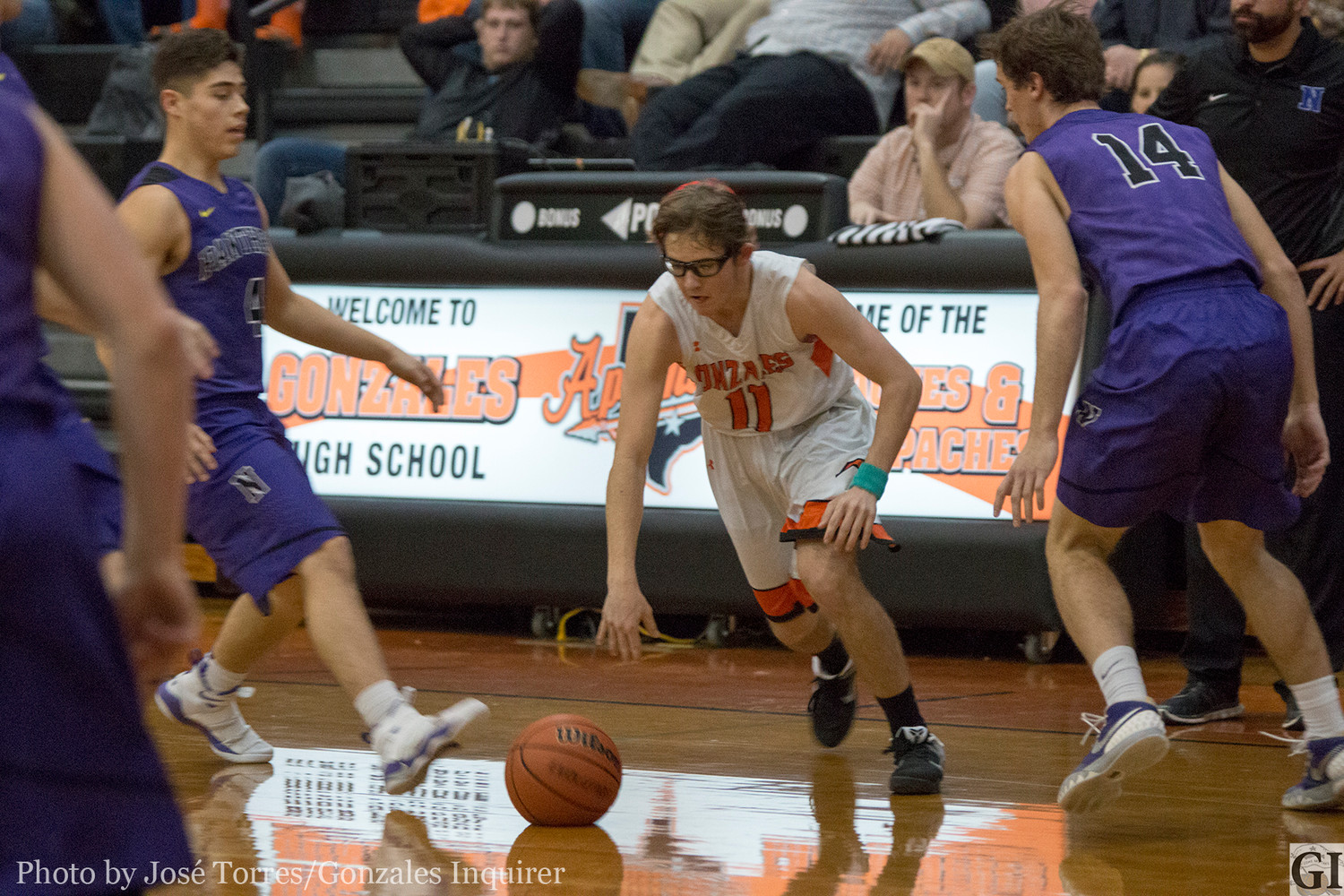 Mason Richter (11) dribbles through defenders in Gonzales' 66-50 loss to Navarro last Friday. Richter ended the night with a team-leading 12 points.