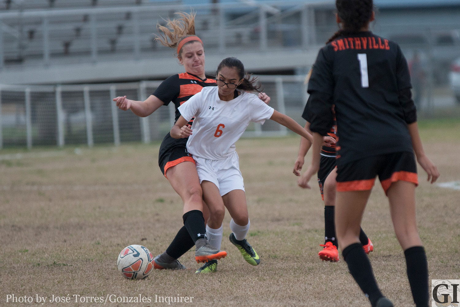 Samantha Gallegos fights for the ball.