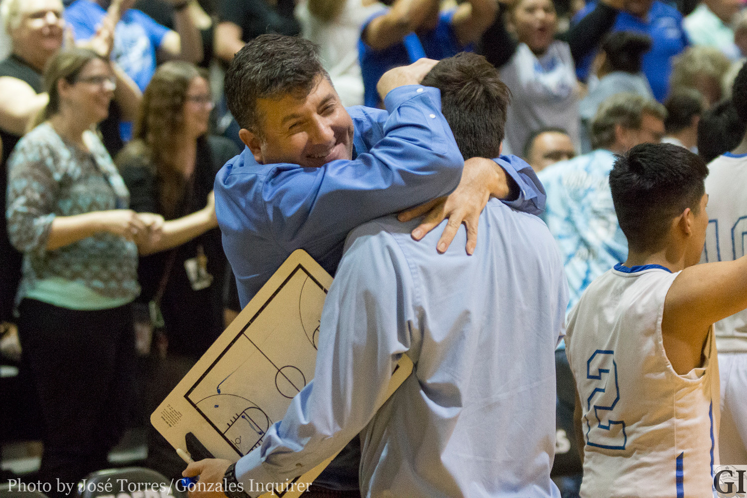 Waelder Superintendent Jon Orozco embraces Head Coach Jacob Garcia after the four-point win Tuesday night.