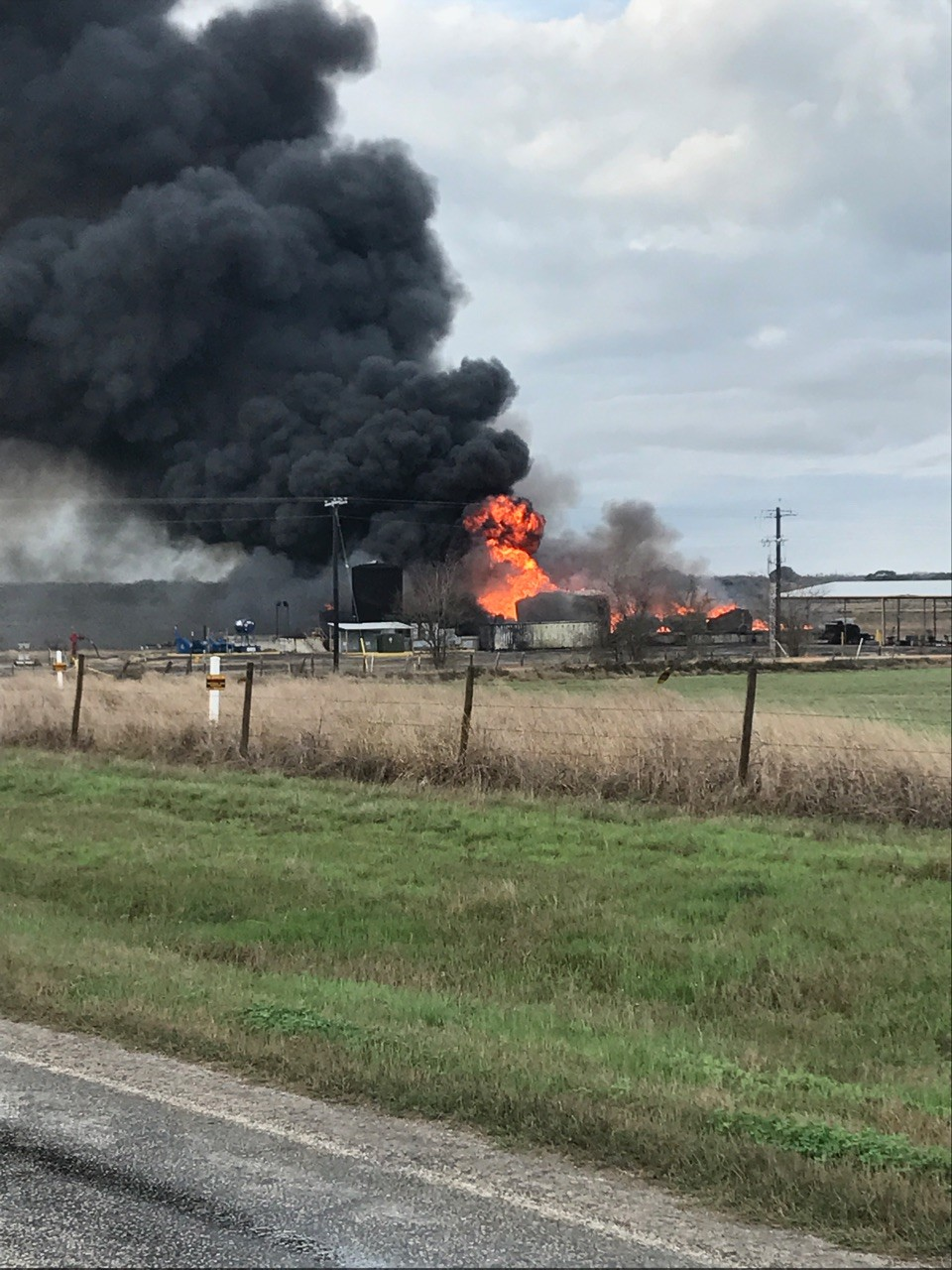 Fire blazes and smoke billows after a lightning strike caused an explosion at an oil storage facility at FM 1116 and CR 206 in southern Gonzales County at 7:30 a.m., on Sunday, Feb. 25. No one was injured in the explosion.