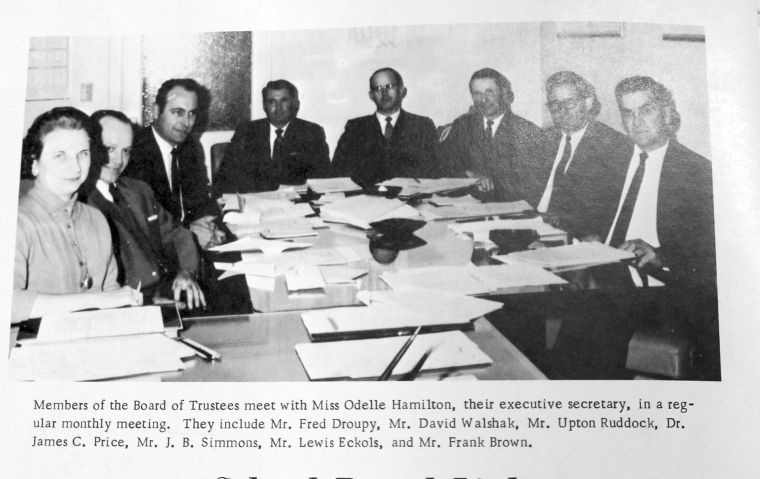 "Dennis Droupy recalls former GISD Superintendent Fred Havel calling this group of school board members ""the best to serve Gonzales."" Shown from left are Executive Secretary Odelle Hamilton, Fred Droupy, David Walshak, Upton Ruddock, Dr. James C. Price, J. B. Simmons, Lewis Eckols and Frank Brown."