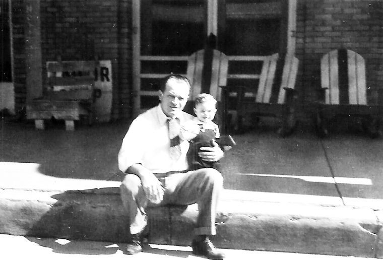 Fred Droupy and Dennis spent a moment on the porch of the hotel.