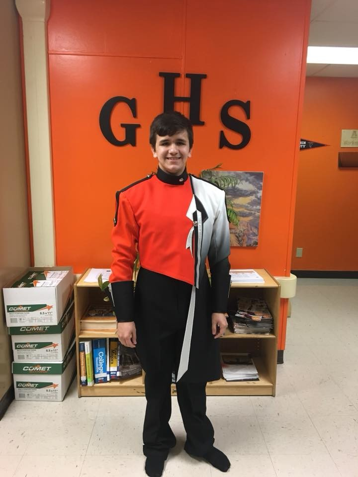 Rising senior Tyler Barfield models the new Mighty Apache Band uniform for the 2018-19 school year. The band will be hosting fundraisers throughout the summer to help pay for the new threads.