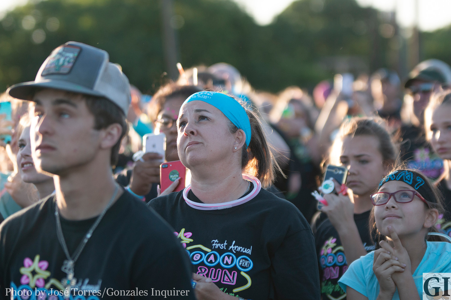 Sarah Farrar, mother of the late Morgan Farrar, looks up at the turquoise balloons released to the sky in honor of Morgan last Saturday at Independence Park.