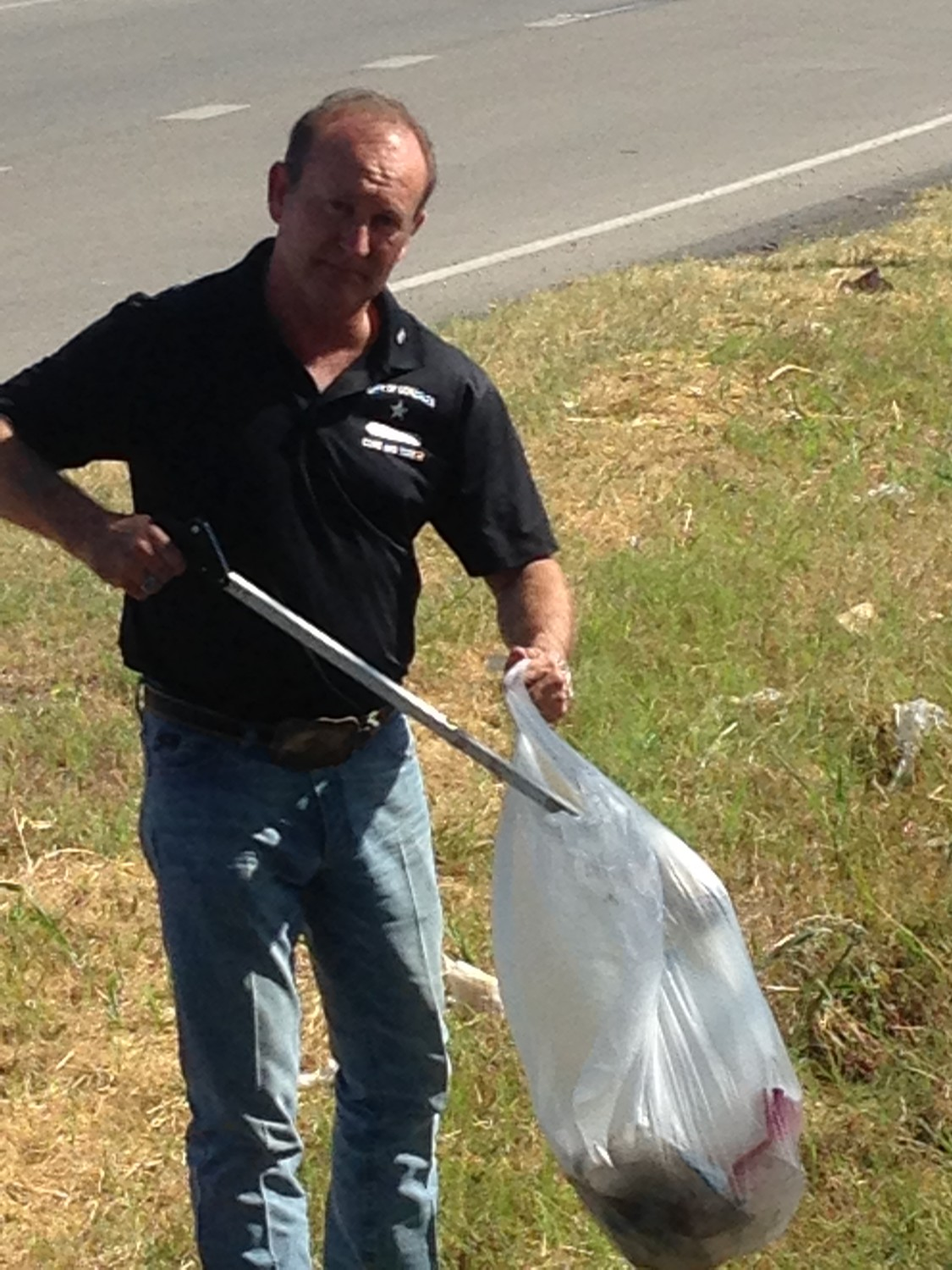 Gonzales City Tourism Director Clint Hille helped clean up trash along the highway near J.B. Wells over the weekend.