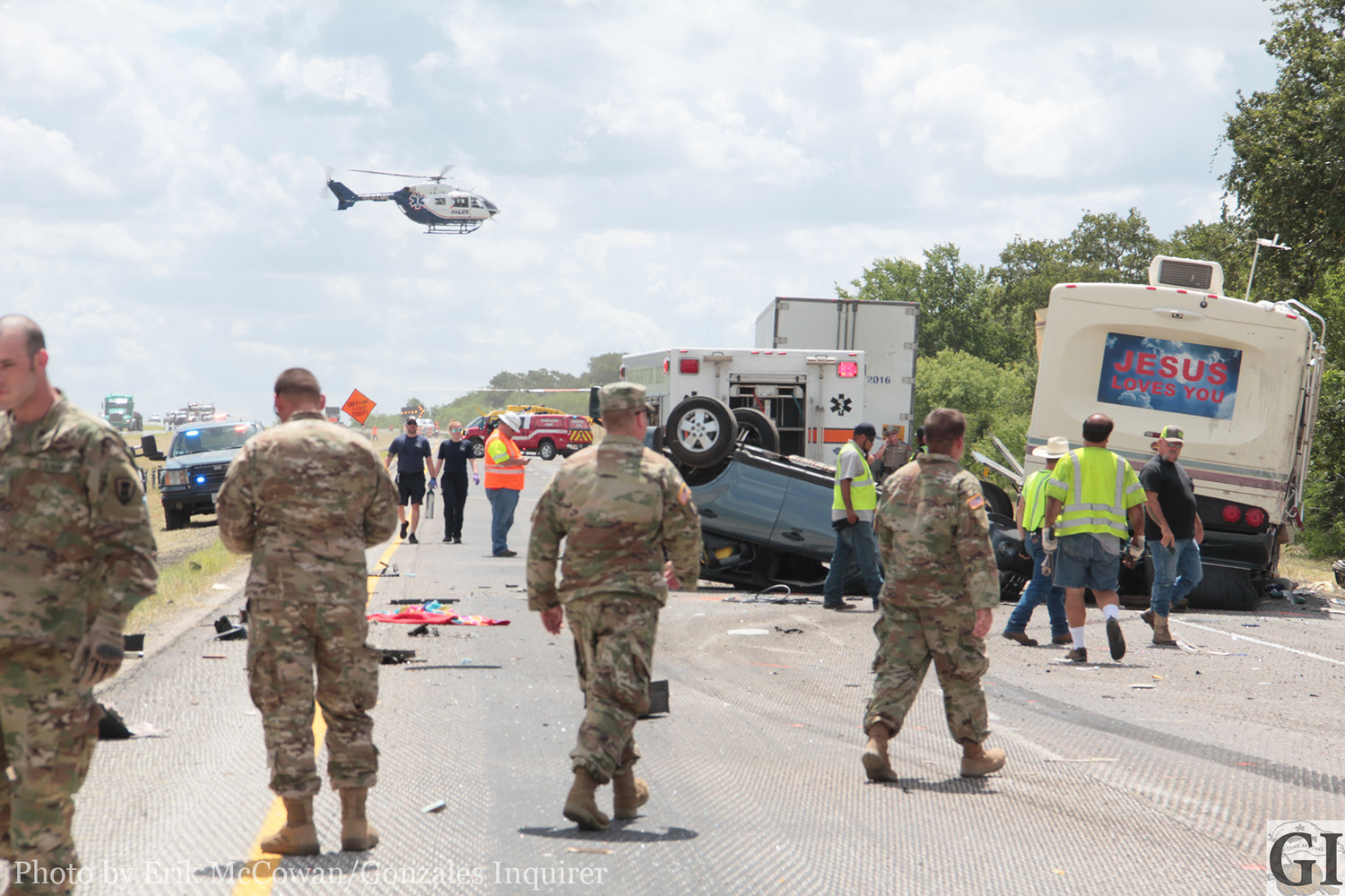 Members of the Texas National Guard's 442nd Engineering Company from Angleton are seen assisting at the scene of a major crash last week on I10 that took the lives of two occupants of an RV. The soldiers were headed home from a weekend of training and were the first on scene to render aid and support to the victims.