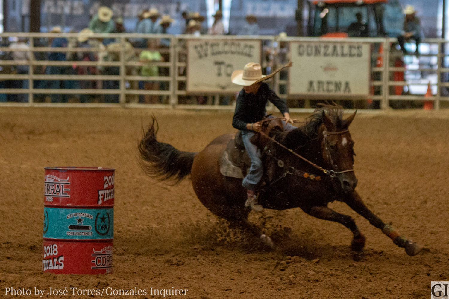 Orange Grove's Tylar Ellis rounds the barrels during her rodeo performance on Tuesday night.