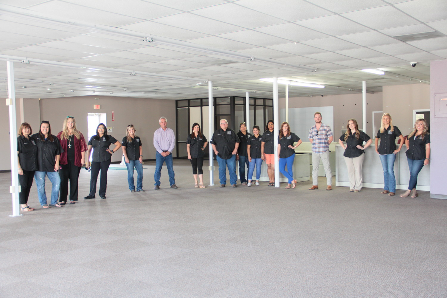 Members of the Gonzales Chamber of Commerce and Agriculture board of directors stand inside their future home downtown. The spacious building is on Texas Heroes Square across from the flag pole in the former GVEC building, which should make it an easy-to-find location for visitors.