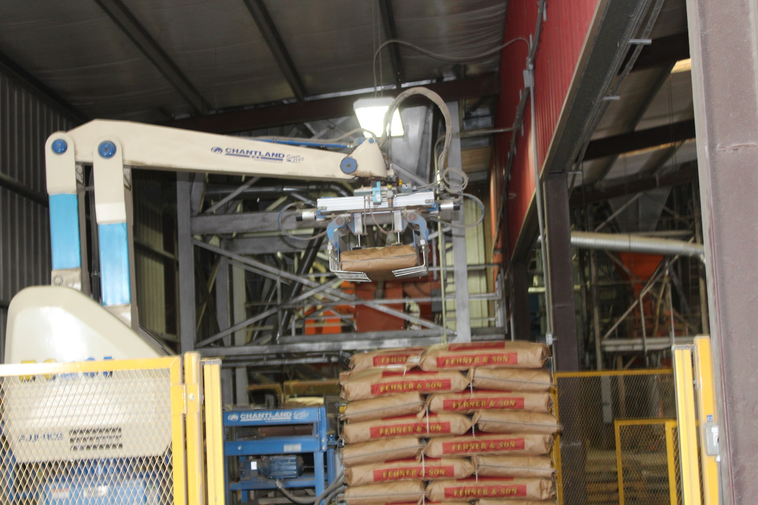 In 2007, this robot started the automation process at Fehner. The robot stacks feed bags, and then 8 different fork trucks load the pallets and store them around the property