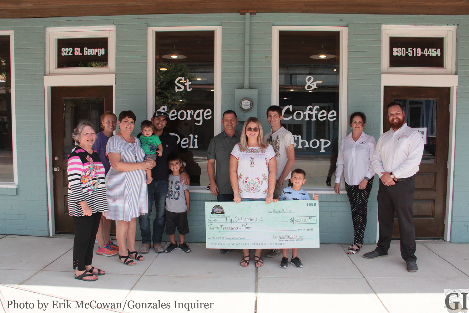 Members from Gonzales Main Street and the Gonzales Economic Development Corporation joined Jacob and Manda Leal and Linda and Stuart Frazier in front of their new storefront at 318 St. George Street, which is the latest recipient of a $30,000 small business grant to help revitalize the appearance of the building.