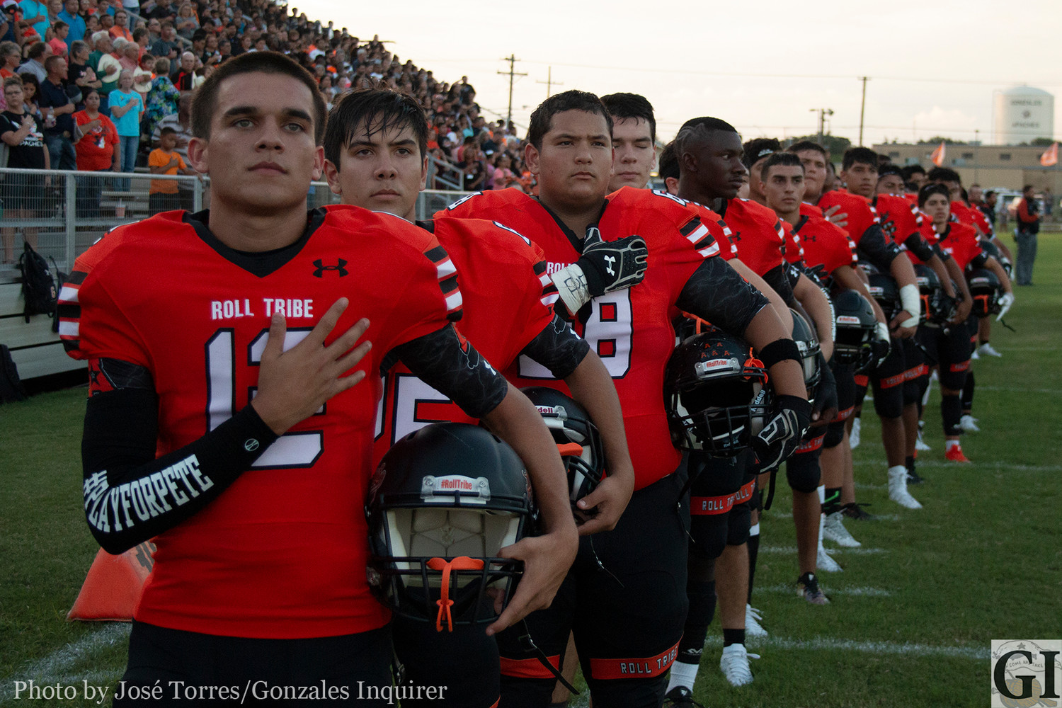 The Gonzales Apaches line up during the pre-game national anthem.