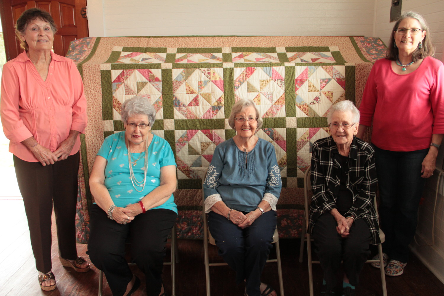 The Happy Quilters are, from left, Margie Rice, Ruth Newberry, Charlene Anderson, Janyce Littlefield, and Terri Porter. You can catch them and their handmade quilt at the Leesville Country Fair on Oct. 13.