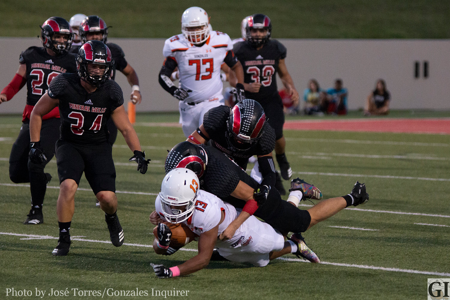 James Martinez (13) gets tackled in the open field in Gonzales' 38-21 loss against Mineral Wells