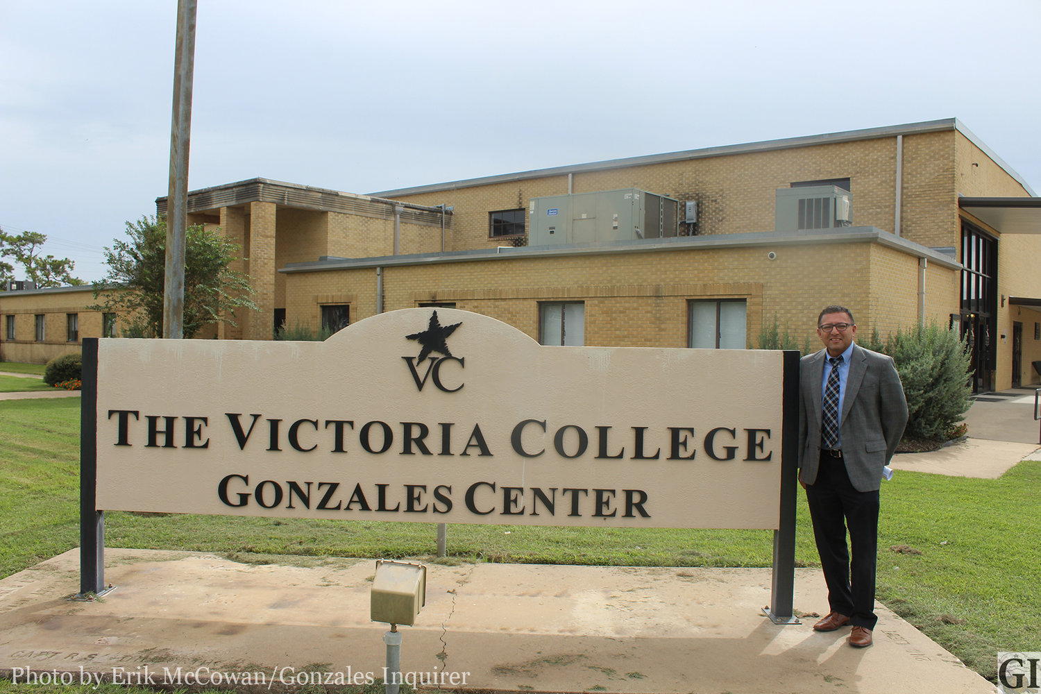 Since 2007, Victoria College's presence in Gonzales has helped many citizens and area businesses. Manager Vince Ortiz stands proudly in front of the Gonzales Center marker on Monday afternoon.
