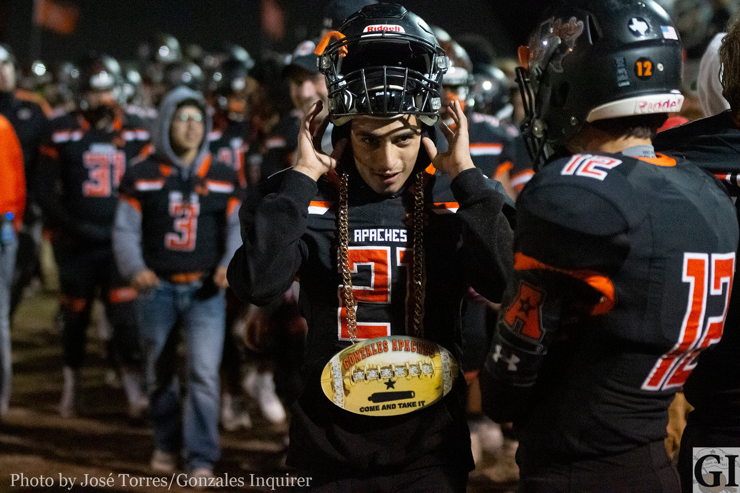 The turnover chain had to be passed around a bit as the Apaches defense played tough against the Boerne Greyhounds. Domingo Garcia (21) let's his chain hang low in Gonzales' 35-28 win.