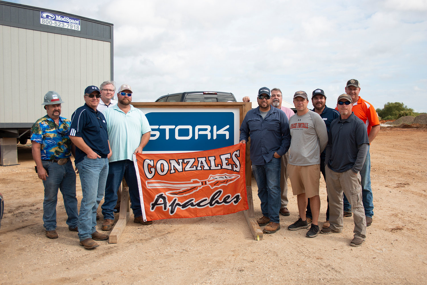 Picture J.D. Woolery (STORK), Steve Register (STORK), Sam Richardson (BYK), Kevin Morris (STORK), Jesse Martinez (STORK), Glen West (BYK), Gonzales ISD Athletic Director Kodi Crane, Isaac Beard (STORK), Gordon Russell (STORK), and Apache Athletic Booster Club President Brian Sample.