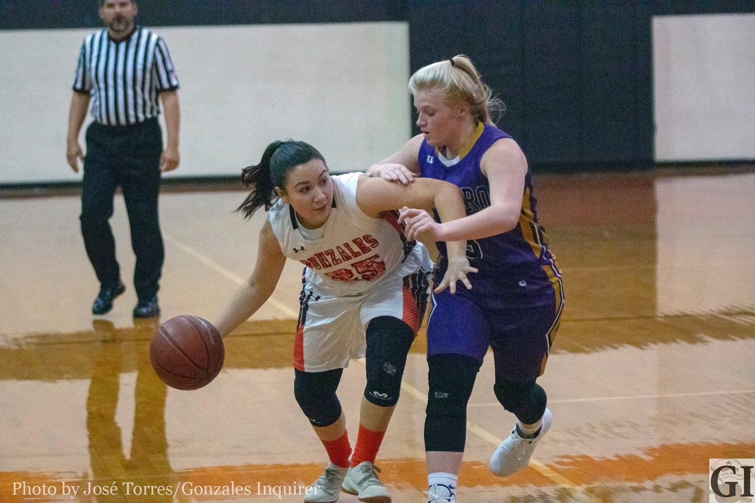 """Chella"" Longoria (25) dribbles through a defender in Gonzales' 58-47 victory over Navarro last Friday, Dec. 21."