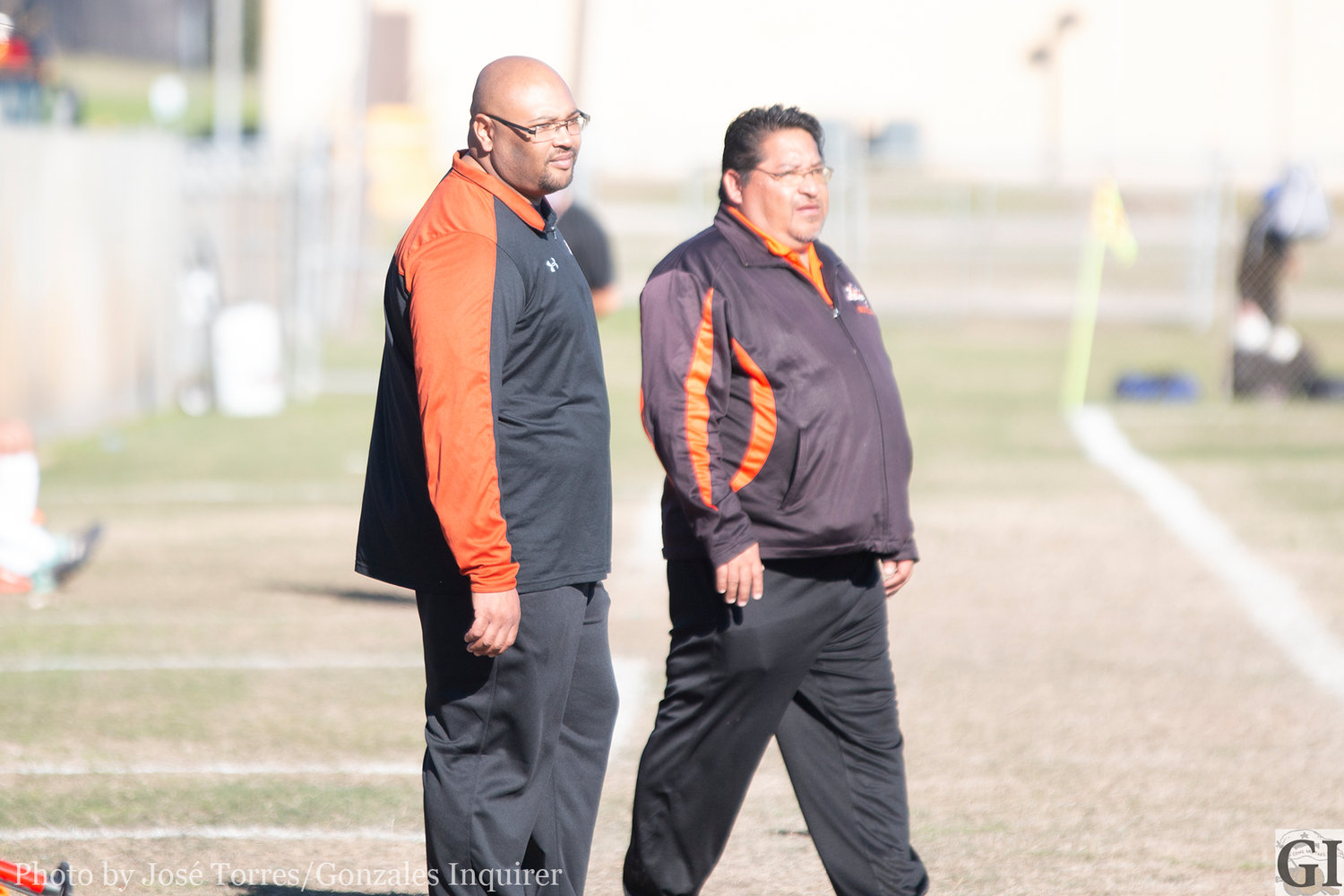 Newly hired coach Anthony Slade (left) looks on with head boys soccer coach Greg Ramirez (right) during Gonzales' inaugural tournament last weekend. Friday was Slade's first day on the job.
