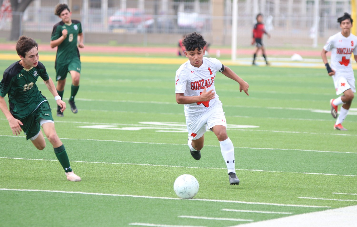 Leading Apaches scorer Anthony Veliz (1) dribbles past a defender.