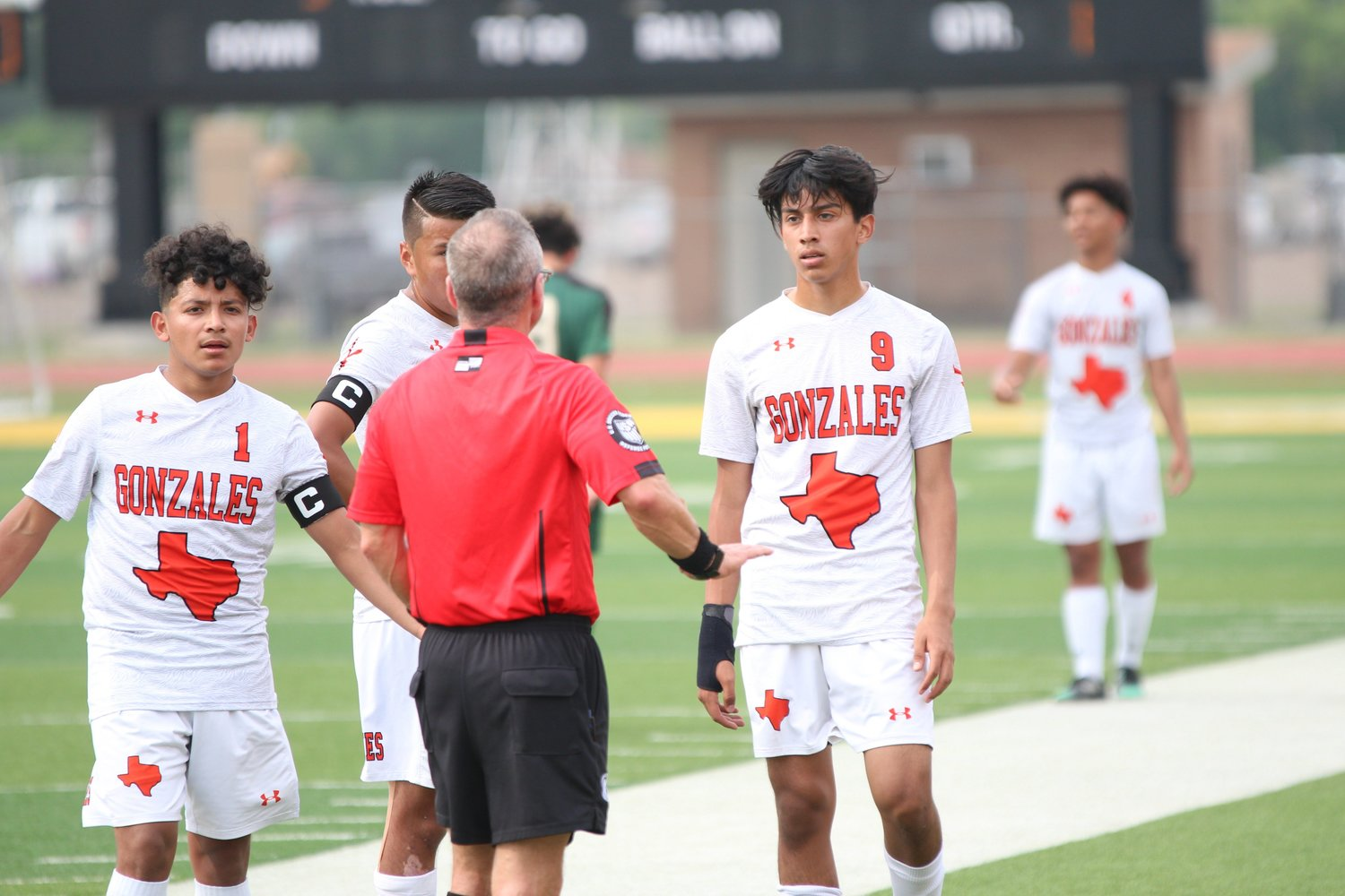 The head official had multiple conversations such as this one with players on both teams throughout the game. Five yellow cards were administered in Canyon Lake's 2-1 victory over Gonzales.