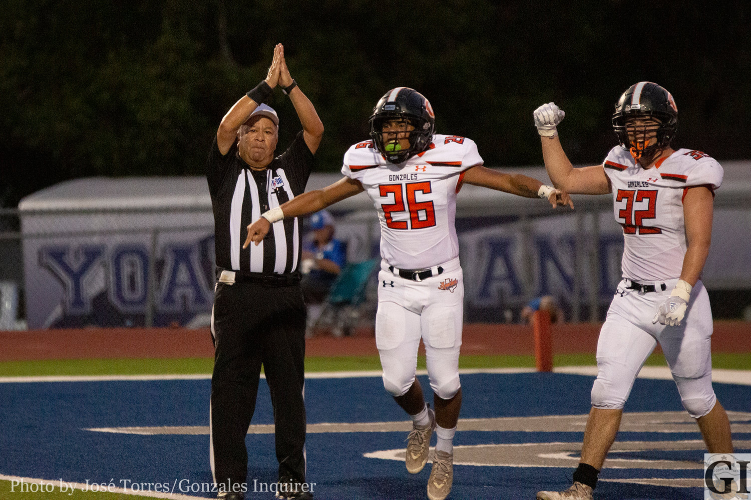 Aaron Guerrero and Diego Diaz de Leon celebrate a safety in the first half of Gonzales' 27-25 win over Yoakum.