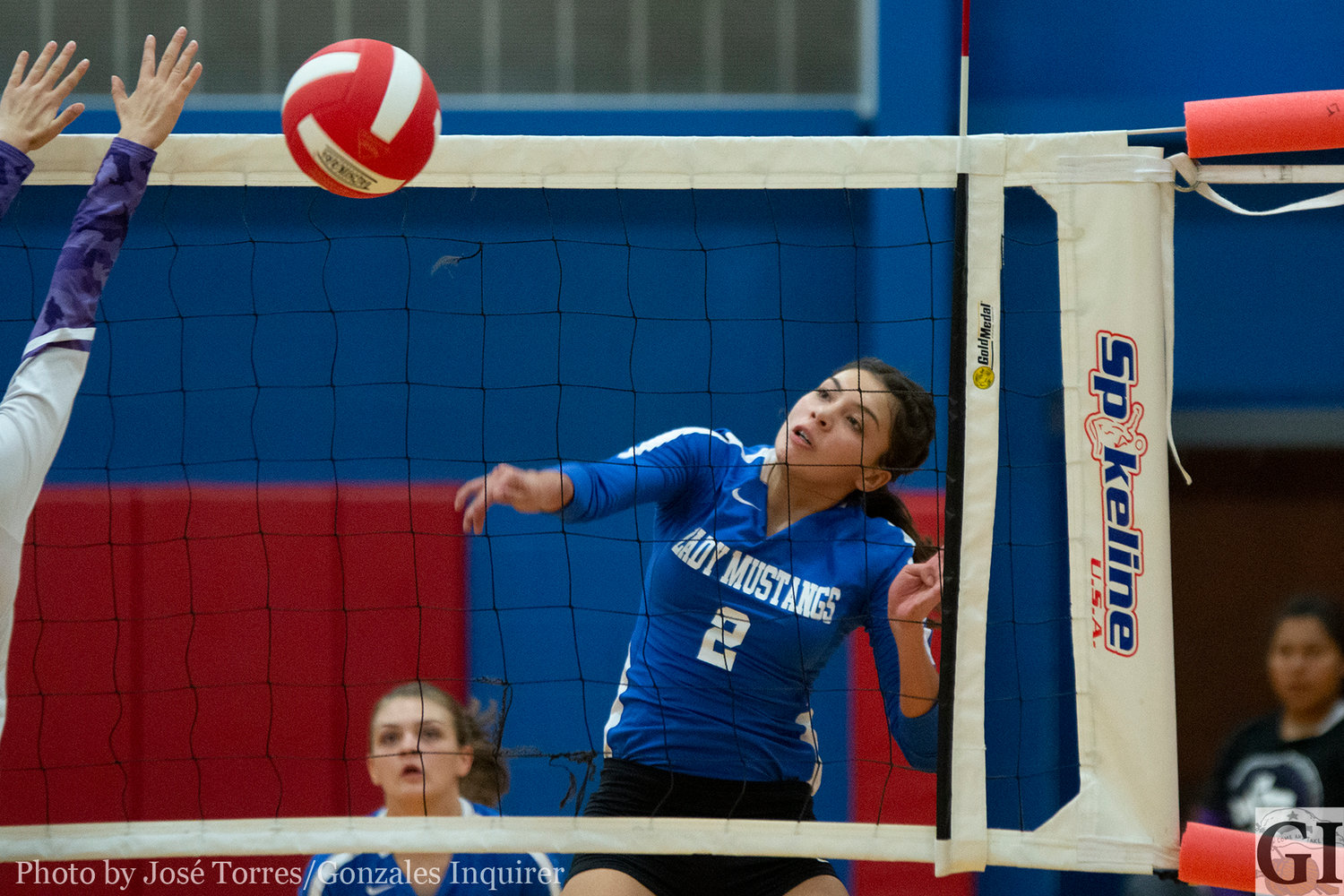 Autumn Rodriguez (2) knocks down a kill in Nixon-Smiley's four-set loss to Stockdale.
