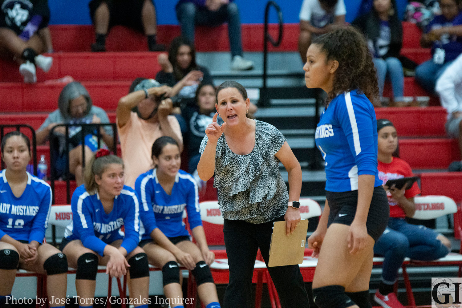 Nixon-Smiley Head Coach Tara Wyrwich shouts out instructions in the loud Mustang Gym on Tuesday.