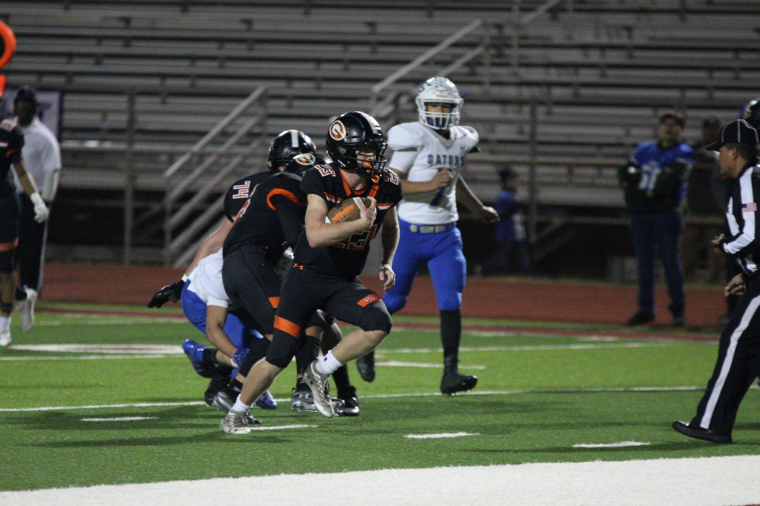 Starting quarterback Heath Henke (23) made his way into the end zone four times in Gonzales' 48-27 victory over Grulla.