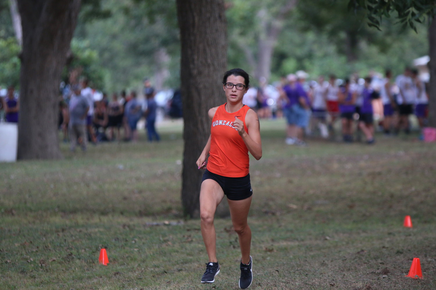 Veronica Moreno turns a corner in the Gonzales Apaches cross-country team's season opening relay race on Aug. 17.