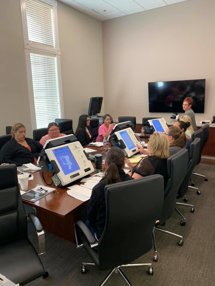 Gonzales County Clerk and Voter Registrar staff attend a training session for the new election equipment in September.