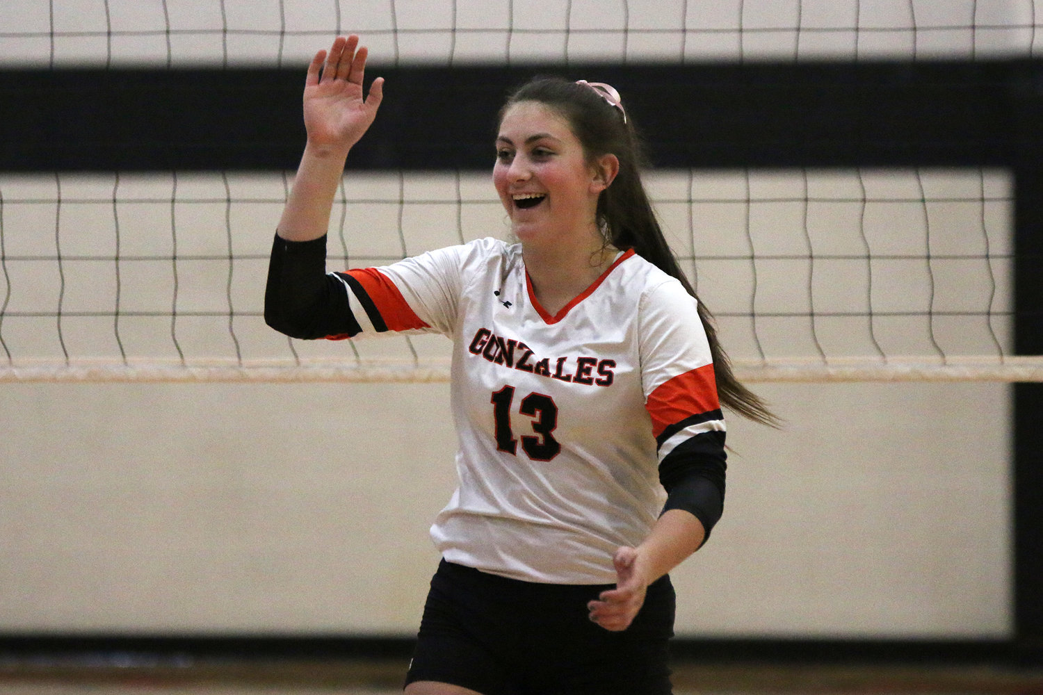 Hayley Sample (13) celebrates a kill in a district win over San Antonio Brooks Academy in October. Sample was named to the District 30-4A first-team all-district list.