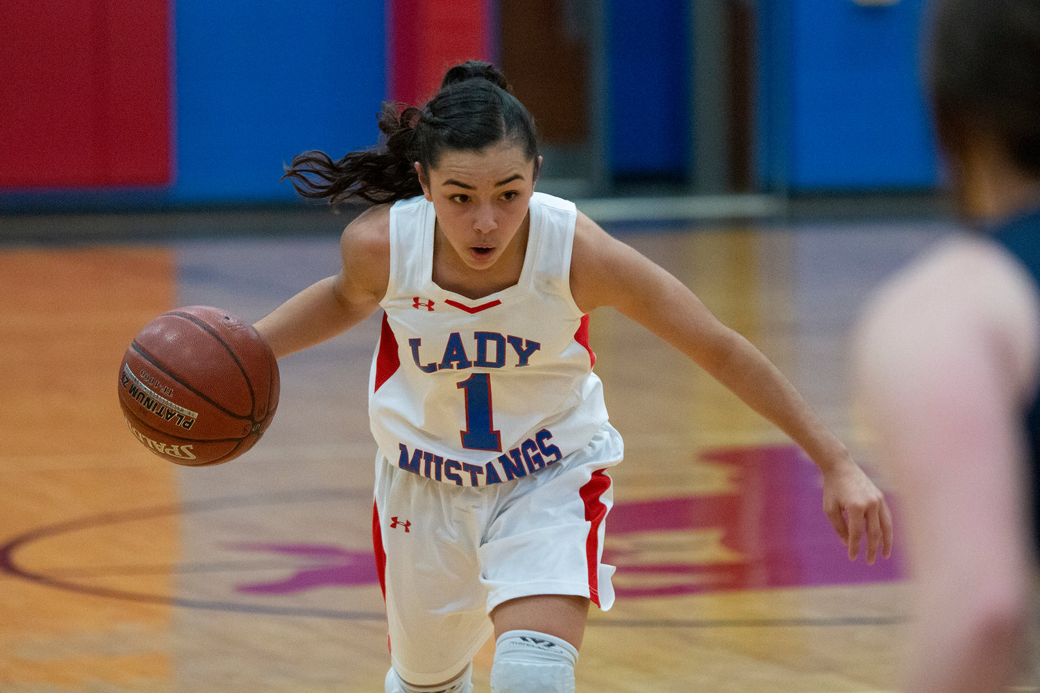Mady Velasquez (1) dribbles down the court in a fast break.