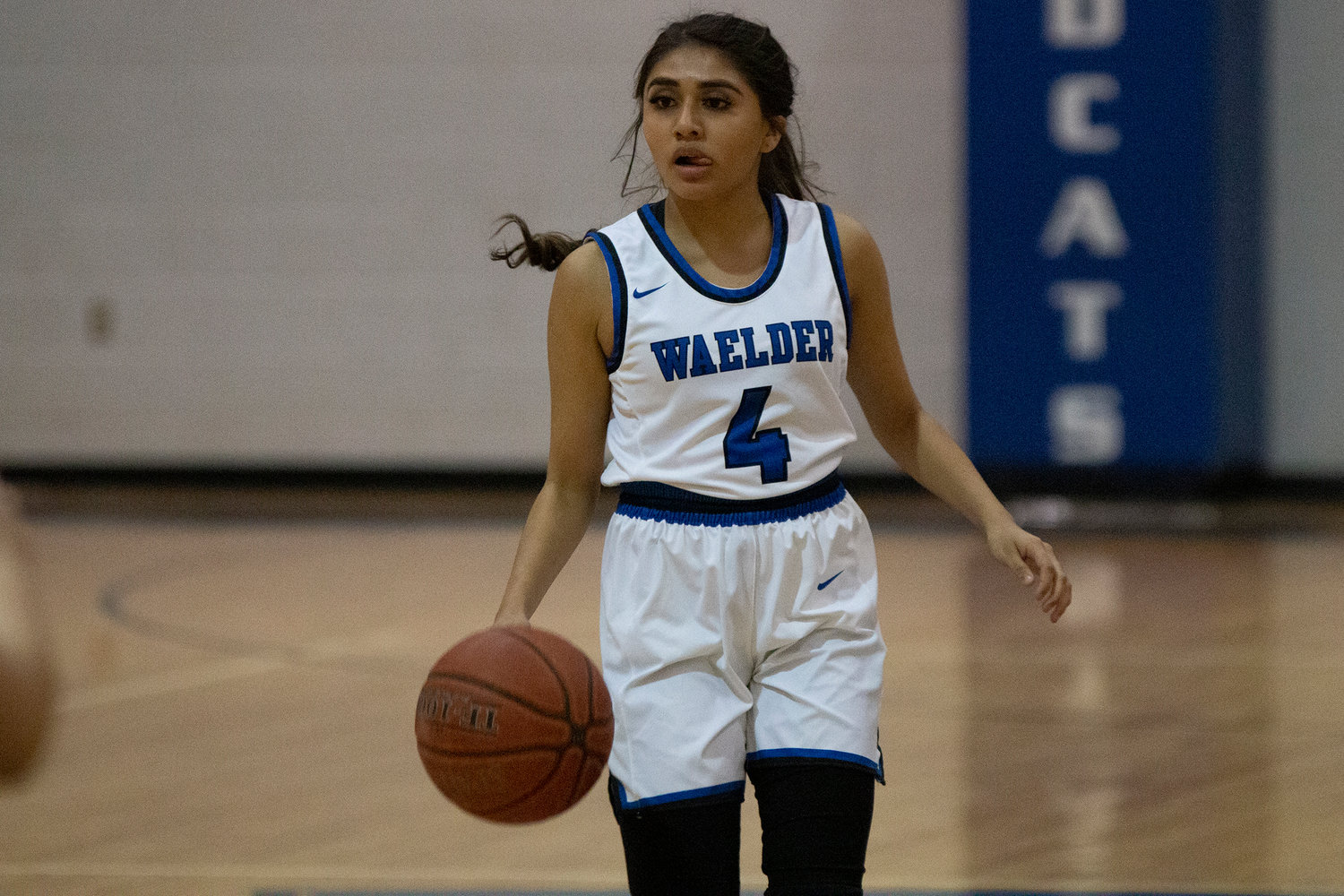 Maely Bracamontes (4) looks for an opening in Waelder's loss against Dime Box last Friday.