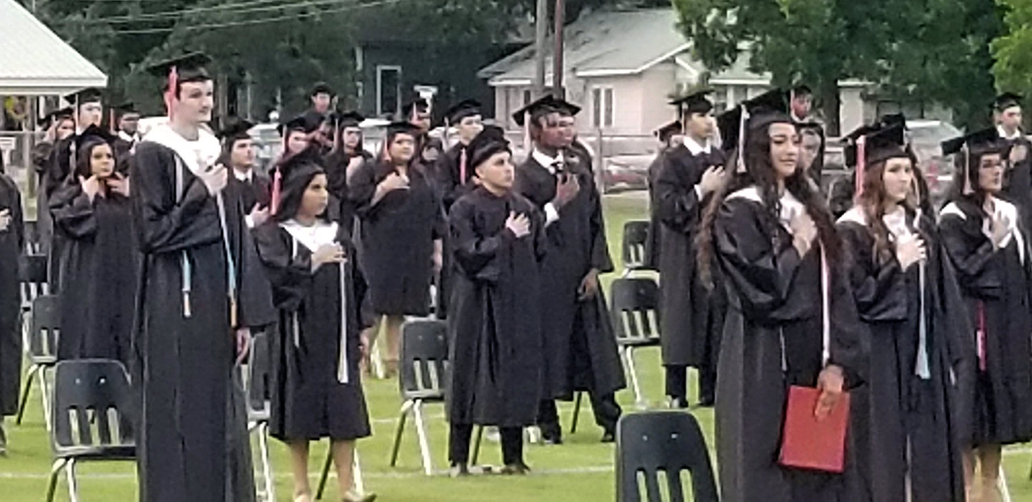 Gonzales High School Class of 2020 graduates recite the pledge of allegiance during their graduation ceremony Friday night.