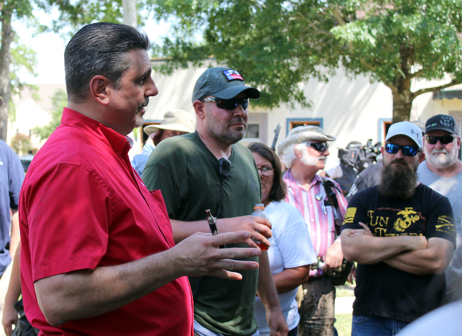 David Amad, left, of Open Carry Texas, and Brandon Burkhart, president of This is Texas Freedom Force, address their gathering Friday afternoon in Confederate Square.
