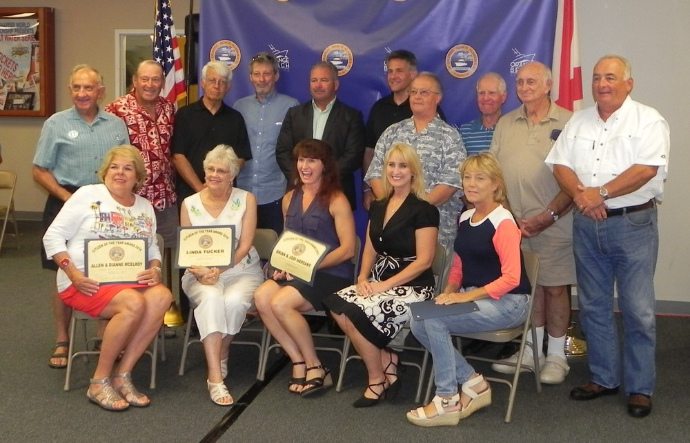 "Seated, from left, are Dianne McElroy, Linda Tucker, Jodi Harsany, Jeanna Bulman and Jane Rodgers, all Citizen of the Year recipients. Standing from left are Allen McElroy, Ron David, John Davis, Ken Cooper, Mayor Tony Kennon, Brian Harsany, Ralph Moore, Peter Rabideau, Mike O'Rouke and Lee Rodgers. All were Citizen of the Year recipients except for Rabideau who was given a Mayor's Distinguished Service Award. Not shown is 100-year-old Haddox ""Sunny"" Autrey who received a Mayor's Distinguished Award as well."