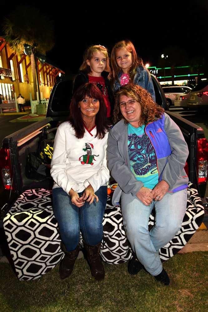 Vicky Fry,   Kaylie   Alexander,   Janse   McClure, and   Daize Stone   tailgating   and waitilng   along route   for parade