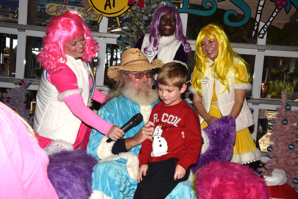 Jackson   Hughes   visits with   Billy Claus   and the   LuLubelles.