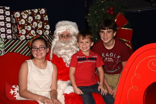 Zach, Abby   and Carter   Bourgeois   with Santa.