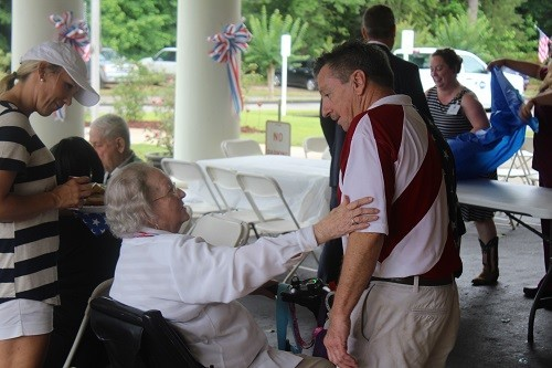 Tom Boyington greets a veteran at the American Heroes Memorial Day Cookout at the William F. Green State Veterans Home in Bay Minette on Monday.